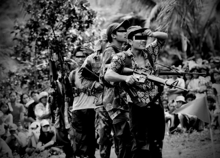 """DOWN THE LONG AND ARDUOUS ROAD. Red fighters of the New People's Army interpret through dance the long and arduous road the people must take before winning what they call """"true democracy for the people"""" 