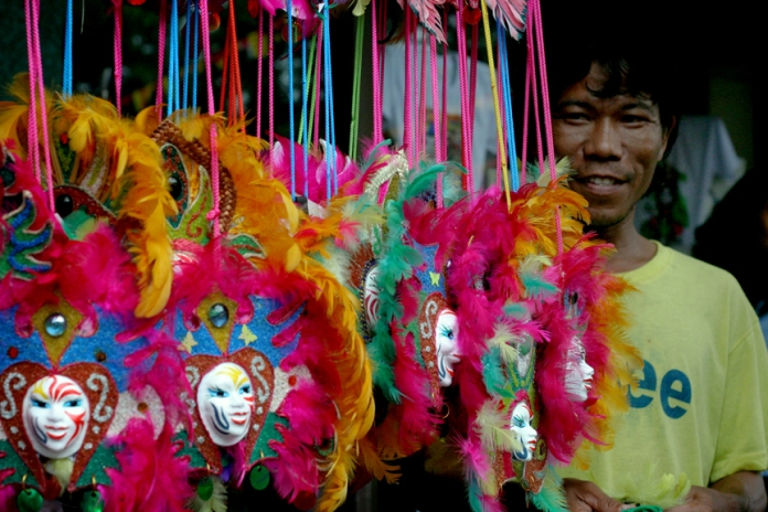 AS THE BER MONTHS START, one awaited event in Bacolod City is the MassKara Festival that was born out of twin tragedies, one of which is the sugar industry crisis. ARTISAN FOR A MONTH, SIKAD DRIVER FOR THE REST OF THE YEAR. Renante Pajes is a mask designer | He is a former government employee | Now he is back to plying the streets, earning a few pesos for every passenger | But he sets aside a part of his earnings to designing masks during the MassKara Festival | He has been at it, he says, for more than 15 years | Photo by Julius D. Mariveles . All photos taken 2011.
