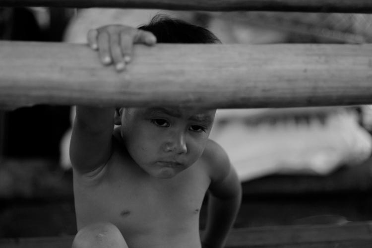 BOY ON BAMBOO BENCH | Photo by Julius D. Mariveles