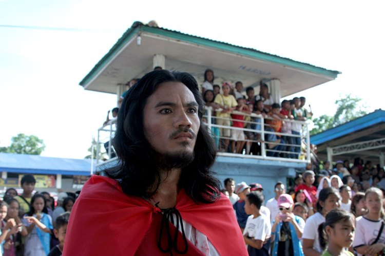 HESUS enters the multi-purpose activity center in the village of La Granja, La Carlota City in Negros Occidental province where a play about the Kalbaryo took place before the procession to Calvary Hill | Photo by Julius D. Mariveles