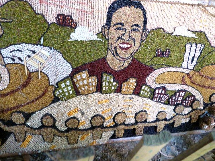 A MOSAIC OF BOARD MEMBER NEHEMIAS DELA CRUZ using corn kernels and mung beans at the Don Salvador Benedicto booth at the Panaad Park and Stadium | Photo by Raya Rojo