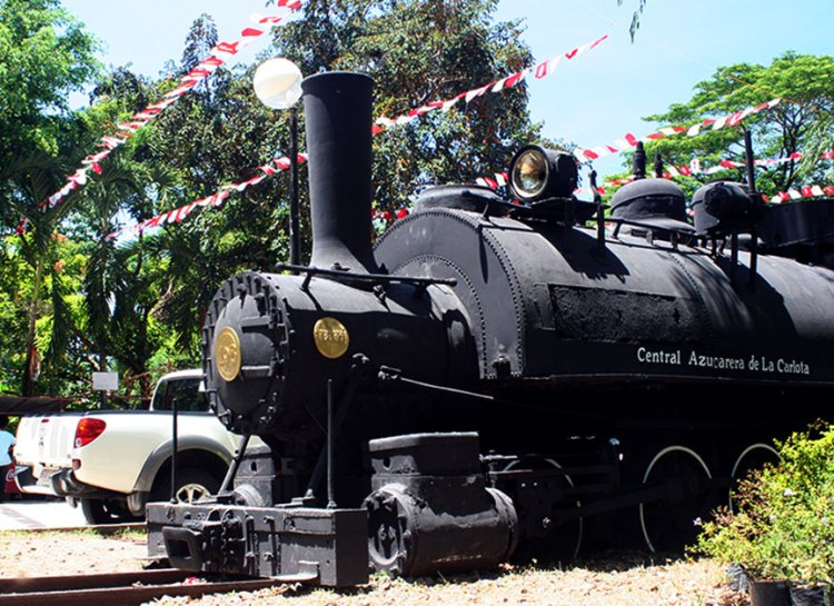 OLD TRAIN, NEW CAR | The old workhorse for the sugar mills, when canes were still brought to the centrales using tracks, is parked at the Panaad Park and Stadium in Mansilingan village... | Photo by Raya Rojo